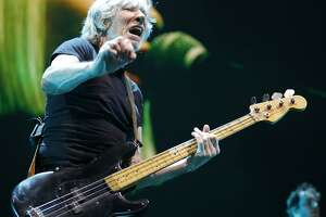 Roger Waters performs during his multimedia Us + Them Tour at the AT&T Center.