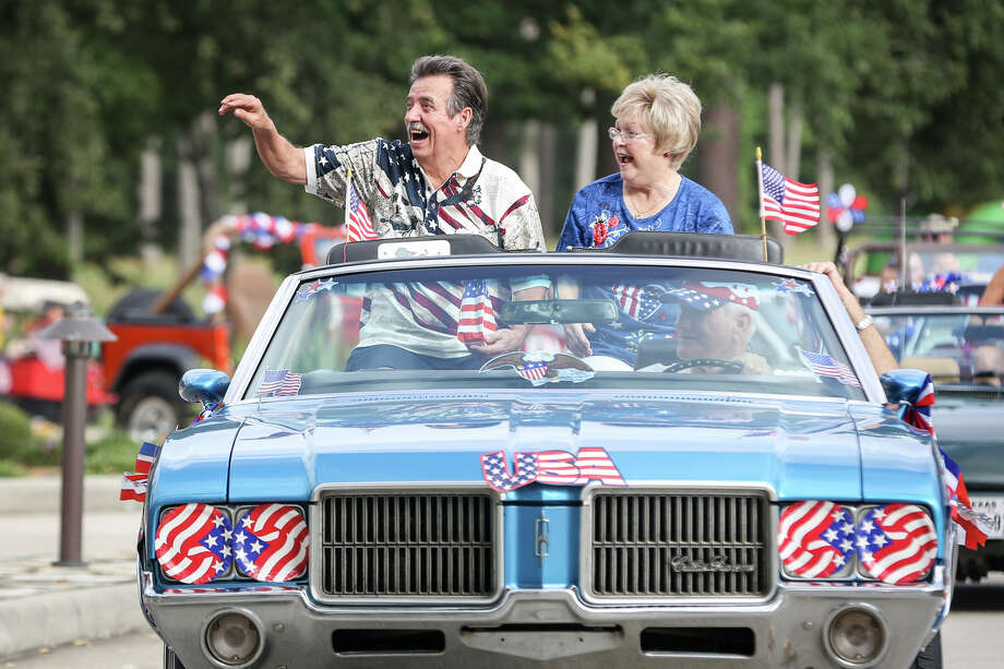 Mayor Lynn Scott and his wife Darlene throw candy and wave to residents during the Panorama Village 4th of July Celebration parade on Saturday in Panorama Village. Photo: Michael Minasi, Staff Photographer / © 2017 Houston Chronicle