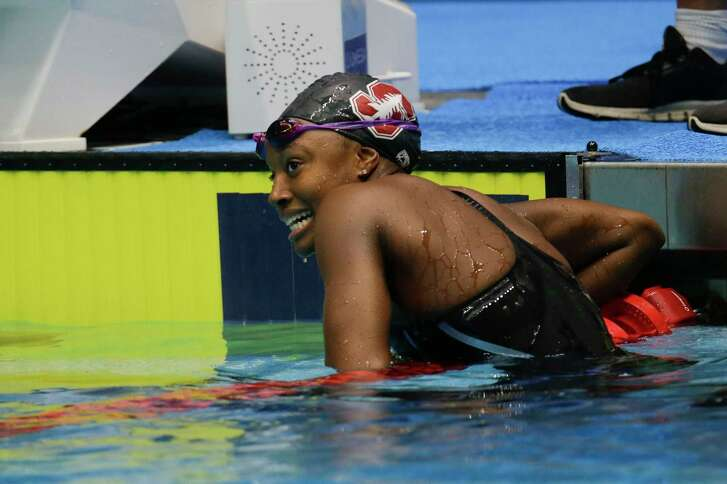 Simone Manuel is all smiles after winning the women's 50-meter freestyle final at the U.S. swimming national championships.