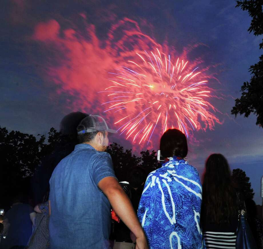Spectators watch the annual Town of Greenwich fireworks display at Binney Park in Old Greenwich, Conn., Saturday, July 1, 2017. Photo: Bob Luckey Jr., Hearst Connecticut Media / Greenwich Time