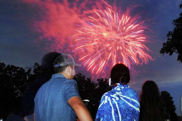 Spectators watch the annual Town of Greenwich fireworks display at Binney Park in Old Greenwich, Conn., Saturday, July 1, 2017.