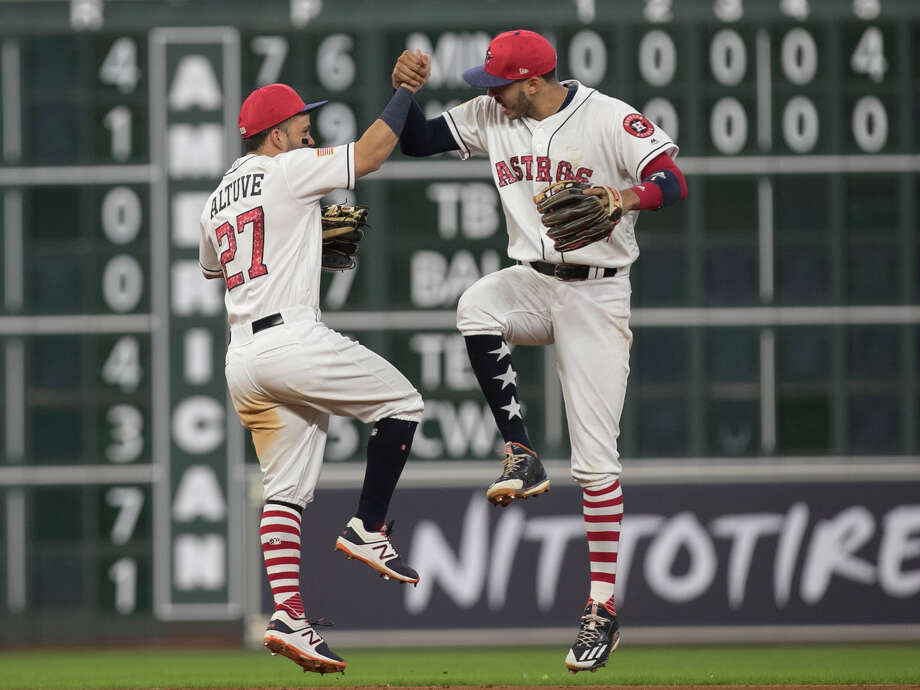 Houston Astros players Jose Altuve (27) and Carlos Correa (1) celebrate the team's win over New York Yankees after the game at Minute Maid Park Saturday, July 1, 2017, in Houston. Houston Astros defeated New York Yankees 7-6. ( Yi-Chin Lee / Houston Chronicle ) Photo: Yi-Chin Lee/Houston Chronicle