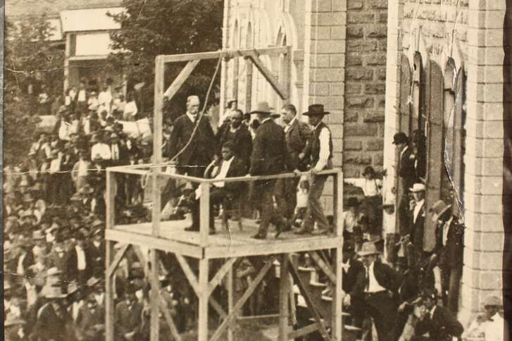 Henry Johnson, seated over the trapdoor moments before his execution in Kaufman County, 1903.