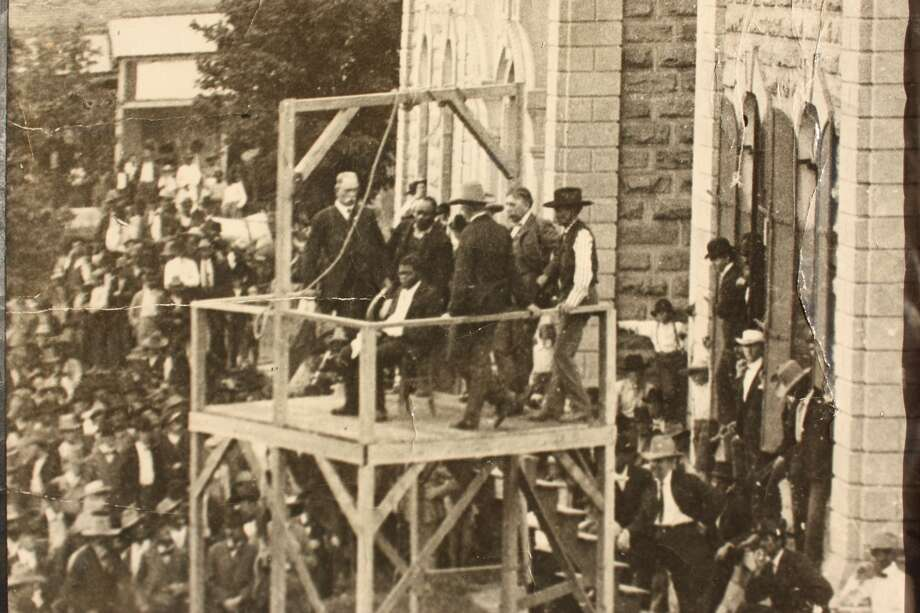 Henry Johnson, seated over the trapdoor moments before his execution in Kaufman County, 1903. Photo: Courtesy Of West Gilbreath