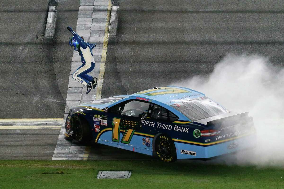 DAYTONA BEACH, FL - JULY 01: Ricky Stenhouse Jr., driver of the #17 Fifth Thrid Bank Ford, celebrates winning the Monster Energy NASCAR Cup Series 59th Annual Coke Zero 400 Powered By Coca-Cola at Daytona International Speedway on July 1, 2017 in Daytona Beach, Florida. (Photo by Matt Sullivan/Getty Images) ORG XMIT: 700069079