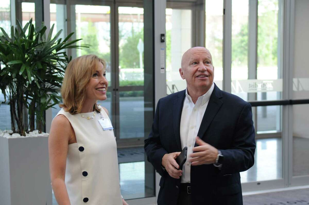 Debbie Sukin, CEO of Houston Methodist The Woodlands Hospital, and Congressman Kevin Brady admire the six-story atrium which provides the new hospital with sunlight.