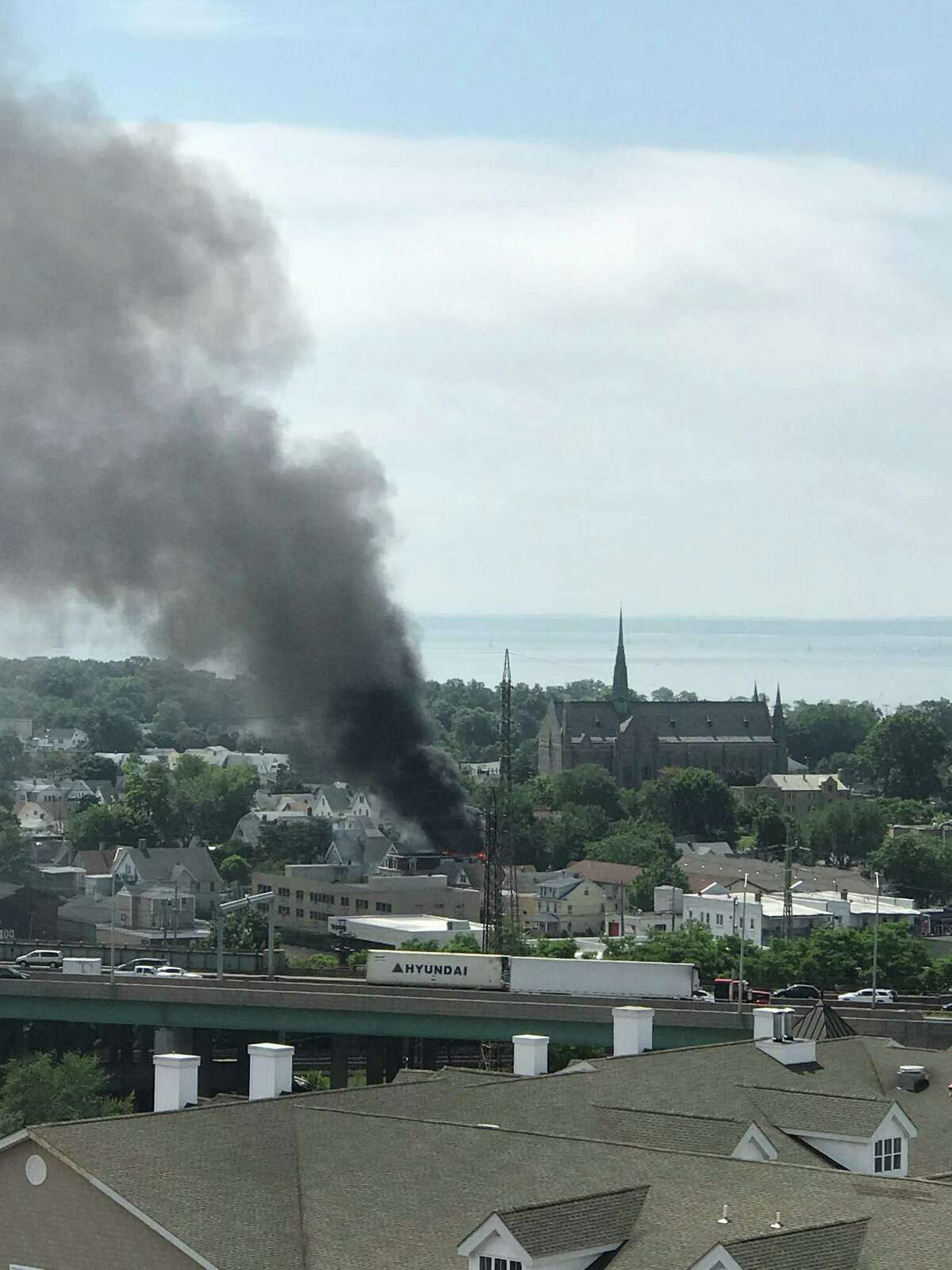 A view of a Warren Street fire on Saturday morning that displaced 12 residents from a three-family home. The photo was taken from a terrace on Glenbrook Road.