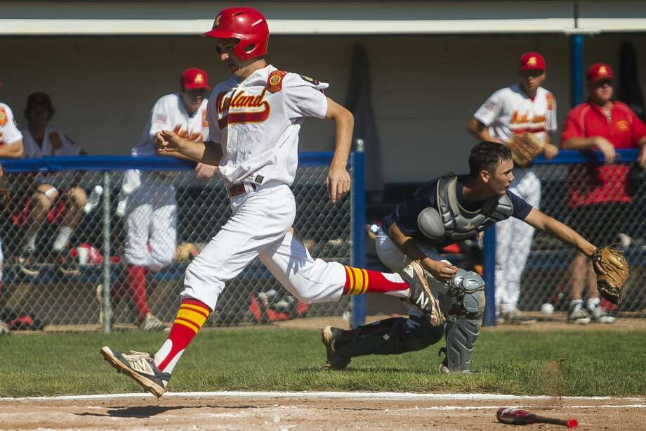 Berryhill Post 165's Jordan Patty scores a run during his team's 9-0 semifinals victory over Means Stamping in the Gabby Mills Invitational on Sunday, July 2, 2017 at Northwood University. Photo: (Katy Kildee/kkildee@mdn.net)