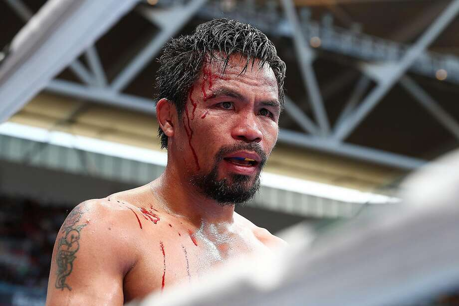 Manny Pacquiao was bloodied and beaten Sunday. Photo: Chris Hyde, Getty Images