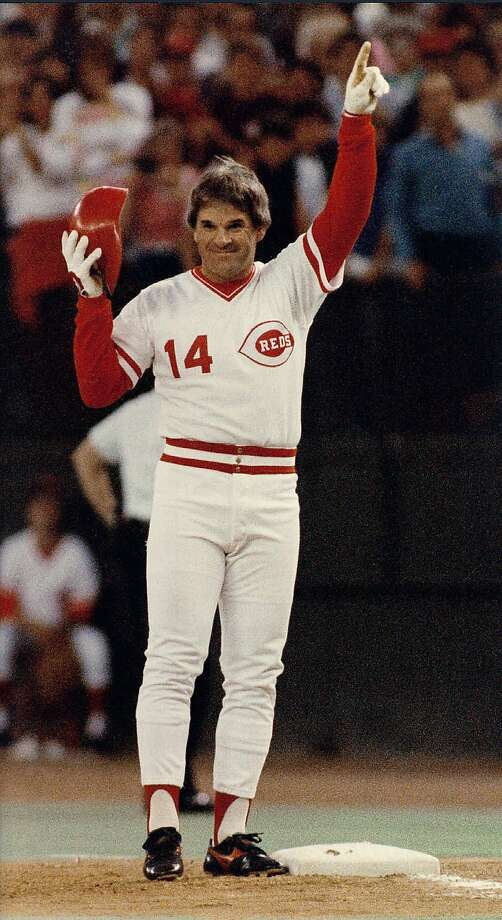 ** FILE ** Cincinnati Reds Pete Rose signals he's #1 after connecting for his 4,192nd career base hit to break Ty Cobb's all-time record in this Sept. 11, 1985 photo in Cincinnati. A 17-time All-Star and former National League MVP, Rose agreed to a lifetime ban from baseball in August 1989 following an investigation of his gambling but has maintained he never bet on baseball. Rose and commissioner Bud Selig met secretly in Milwaukee on Nov. 25, 2002, and their lawyers have been exchanging draft proposals that could end the ban, a baseball executive said Tuesday, Dec. 10, 2002, on the condition he not be identified.  (AP Photo/Bill Waugh) Photo: BILL WAUGH, Associated Press