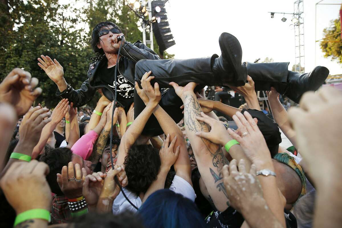 Seiji of Guitar Wolf crowd surfs as he performs during the Burger Boogaloo music festival on Saturday, July 1, 2017, at Mosswood Park in Oakland, Calif.