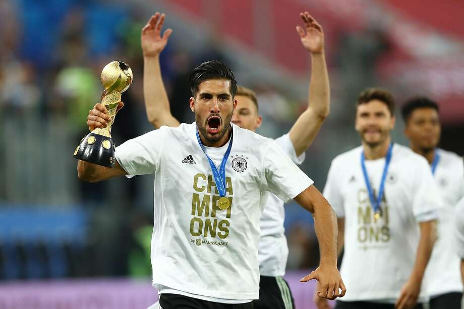 Goal scorer Lars Stindl of Germany hoists the celebrates Confederations Cup trophy. Photo: Dean Mouhtaropoulos, Getty Images