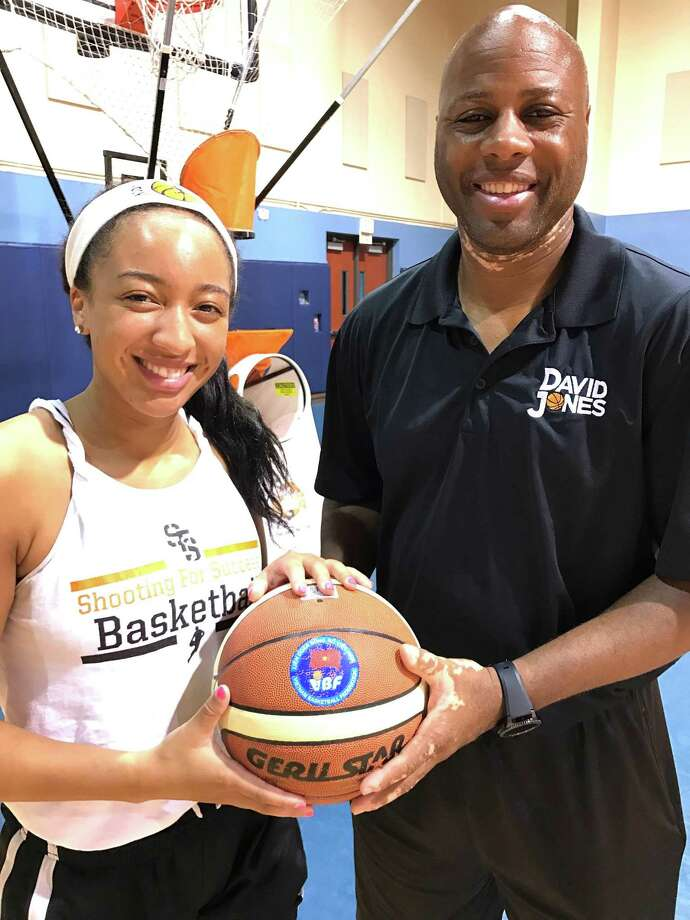 Mailee Jones and her father, David Jones, pose at a recent basketball camp. Photo: Courtesy Photo