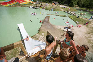 Park goers wait their chance to go down a 22-foot water slide on Sunday, July 2, 2017, at Chadillac's Backyard Waterpark.