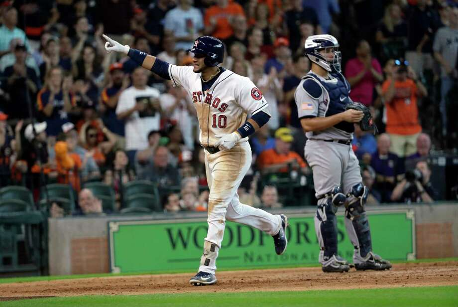 Houston Astros' Yuli Gurriel (10) celebrates after hitting a two-run home run as New York Yankees catcher Gary Sanchez waits during the seventh inning of a baseball game Sunday, July 2, 2017, in Houston. (AP Photo/David J. Phillip) Photo: David J. Phillip, STF / Copyright 2017 The Associated Press. All rights reserved.