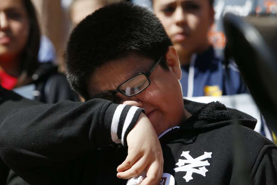 Sergio Govea, 9, wipes tears after reading a statement detailing his anxiety of the possibility that could be losing his parents during the United We Dream rally on the east side of the Texas Capitol to show they do not support Texas Senate Bill 4(SB4) in Austin, Wednesday, March 15, 2017. SB 4 would require all certain state, local, and campus police departments to comply with U.S. Customs and Immigration Enforcement (ICE) detainers. (Stephen Spillman / for Express-News) Photo: Stephen Spillman / Stephen Spillman / stephenspillman@me.com Stephen Spillman