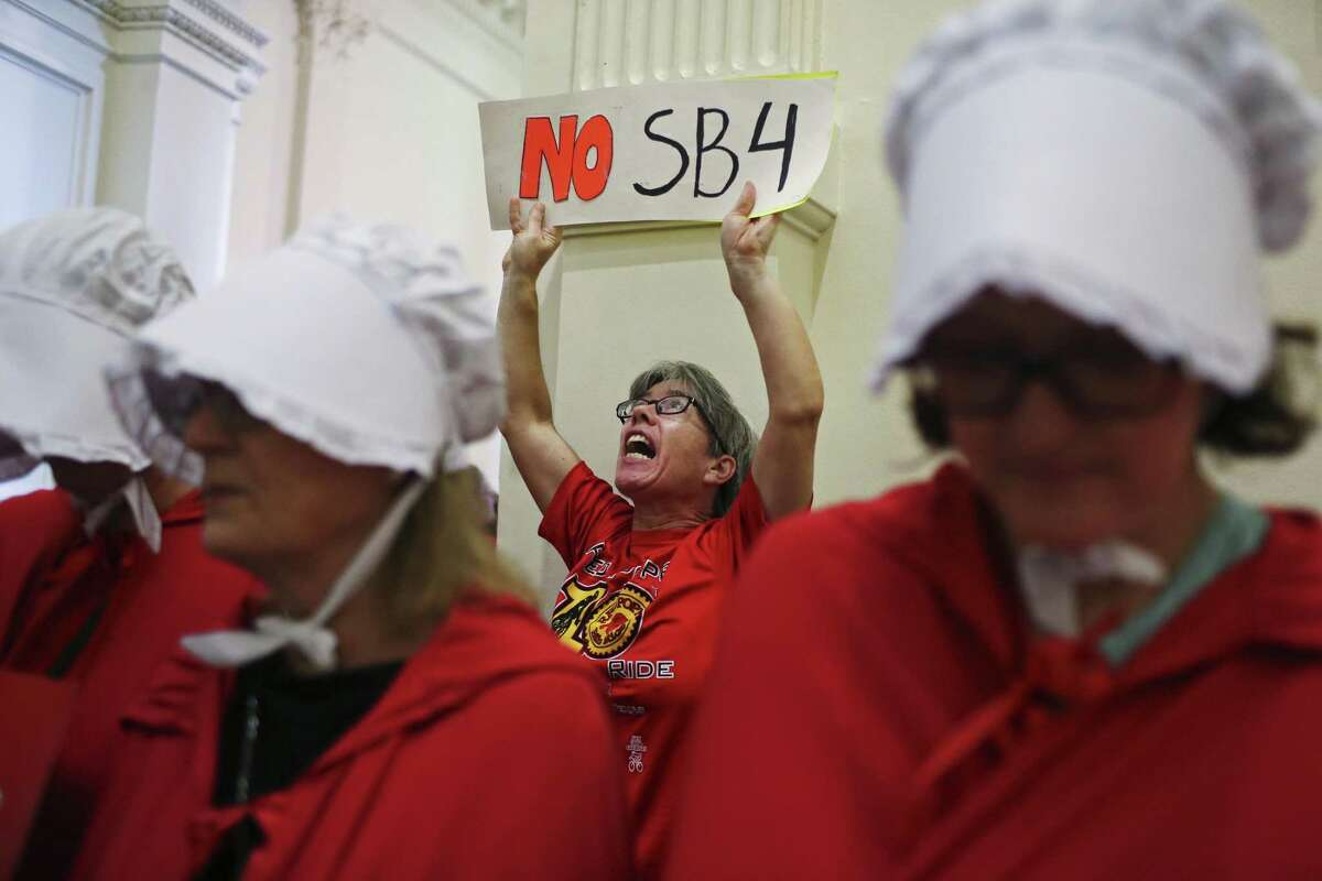 Anita Frishoff protest against SB4 at the State Capitol, Monday, May 29, 2017. The bill, known as Sanctuary City, was signed by Governor Greg Abbott and will take effect on Sept. 1, 2017. It gives local law enforcement department the power to question a person's citizenship.