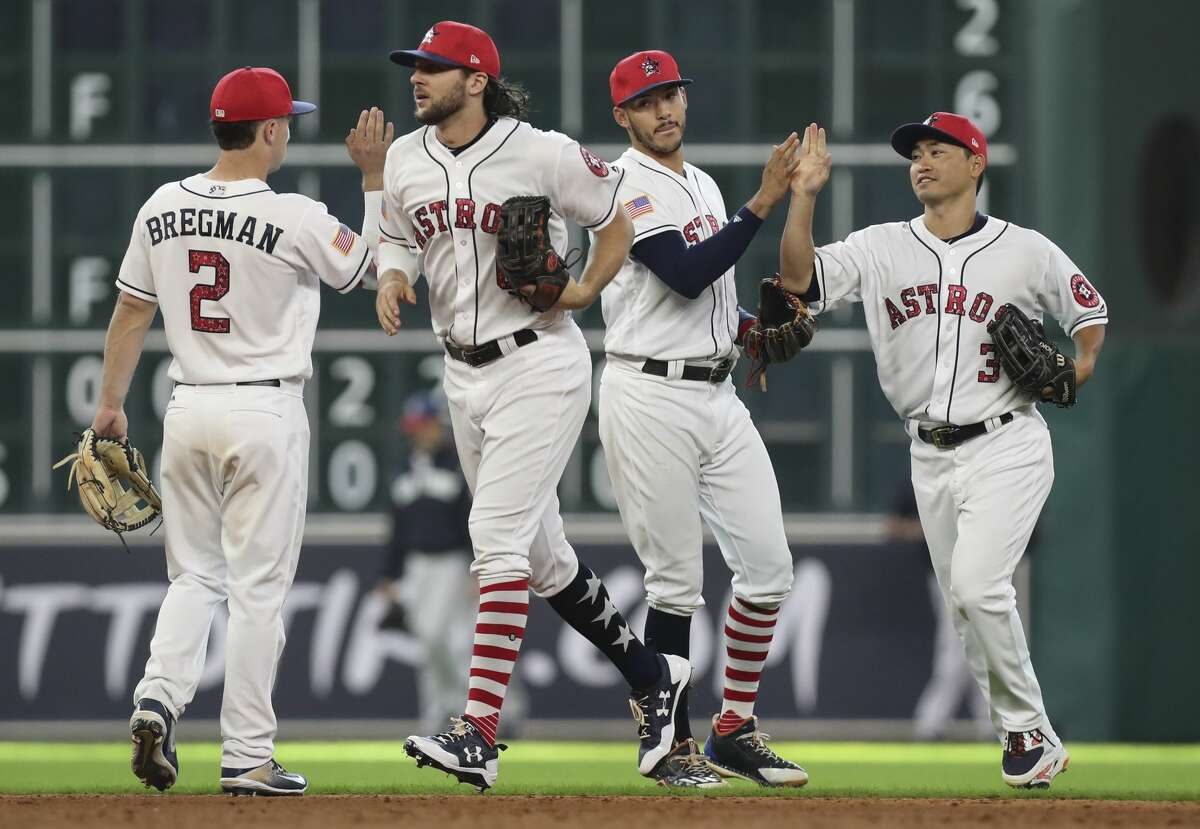 Houston Astros players celebrate the team's win over New York Yankees after the game at Minute Maid Park Sunday, July 2, 2017, in Houston. Houston Astros defeated New York Yankees 8-1. ( Yi-Chin Lee / Houston Chronicle )