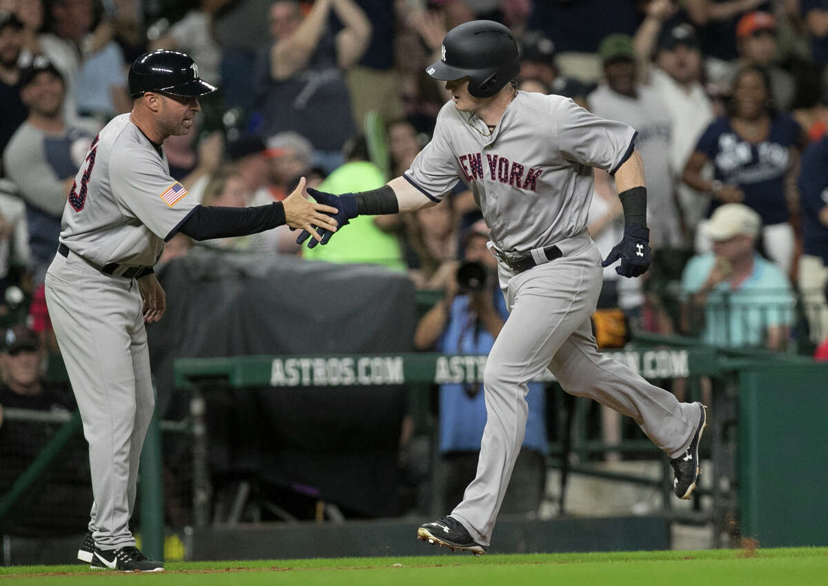 New York Yankees rookie Clint Frazier celebrates with third base coach Joe Espada after hitting his first major league home run during the top seventh inning of the game against the Houston Astros at Minute Maid Park Saturday, July 1, 2017, in Houston. Houston Astros defeated New York Yankees 7-6. ( Yi-Chin Lee / Houston Chronicle )
