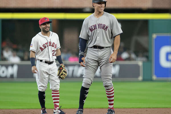 New York Yankees right fielder Aaron Judge (99) and Houston Astros second baseman Jose Altuve (27) has a conversation during the top first inning of the game at Minute Maid Park Sunday, July 2, 2017, in Houston. ( Yi-Chin Lee / Houston Chronicle )