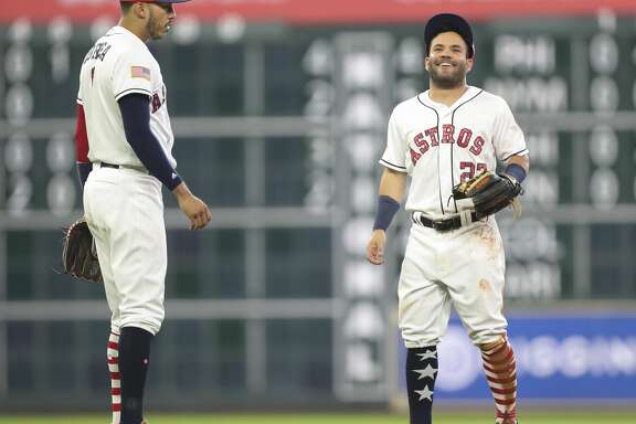 Houston Astros second baseman Jose Altuve (27) and shortstop Carlos Correa (1) are playful during the top fifth inning of the game at Minute Maid Park Sunday, July 2, 2017, in Houston. ( Yi-Chin Lee / Houston Chronicle )