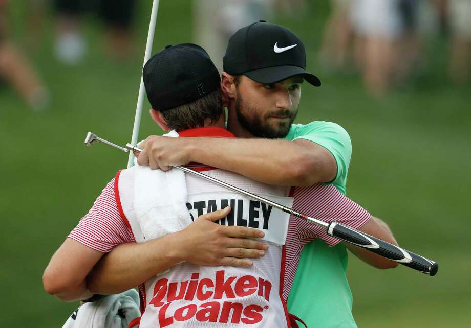 Kyle Stanley hugs his caddy Brian Reed after winning the Quicken Loans National golf tournament, Sunday, July 2, 2017, in Potomac, Md. Stanley won in a playoff. (AP Photo/Alex Brandon) Photo: Alex Brandon, STF / Copyright 2017 The Associated Press. All rights reserved.
