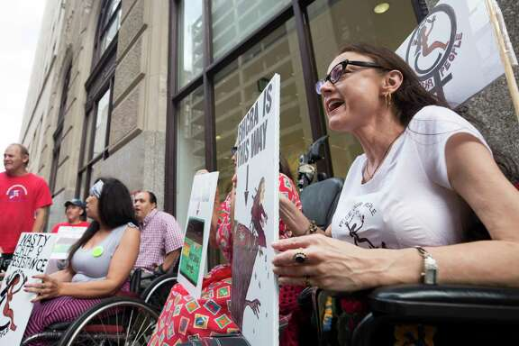 Lydia Nunez Landry, right, chants alongside fellow members of ADAPT, American Disabled Attendant Programs Today, during a demonstration to protest current GOP health care plans outside the building where Senator Ted Cruz's office is located Wednesday, June 28, 2017, in Houston. ( Godofredo A. Vasquez / Houston Chronicle )