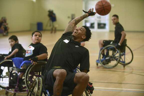 Dejounte Murray of the Spurs participates in a South Texas Regional Adaptive & Paralympic Sports wheelchair basketball clinic at Morgan's Wonderland on June 28, 2017.