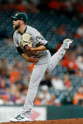 Oakland Athletics starting pitcher Jesse Hahn (32) pitches during the first inning of an MLB baseball game at Minute Maid Park, Wednesday, June, 28, 2017.  ( Karen Warren / Houston Chronicle )