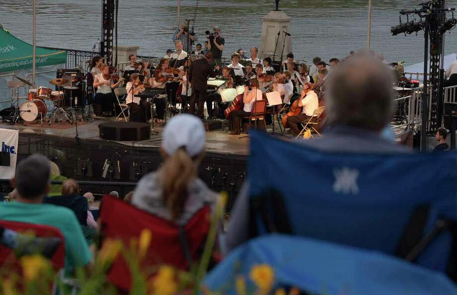 People gather at Jennings Landing to listen to the Albany Symphony orchestra, under the direction of David Alan Miller, perform Water Music NY on Sunday, July 2, 2017, in Albany, N.Y.  This was the first night of a series of Erie Canal side concerts being played by the orchestra.  (Paul Buckowski / Times Union) Photo: PAUL BUCKOWSKI / 20040925A
