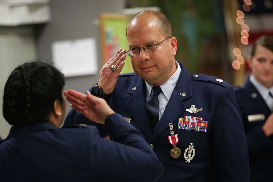 Air Force Lt. Col. Robert Todd Bridges salutes as Air Force Col. Kathy Pallozzi presents him with the Meritorious Service Medal during his retirement ceremony on Saturday at Conroe VFW Post 4709. Photo: Michael Minasi, Staff Photographer / © 2017 Houston Chronicle
