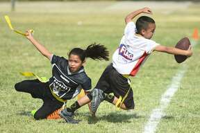 More than 300 children are participating in Laredo's first year of the NFL Flag Football League this summer at Slaughter Park.