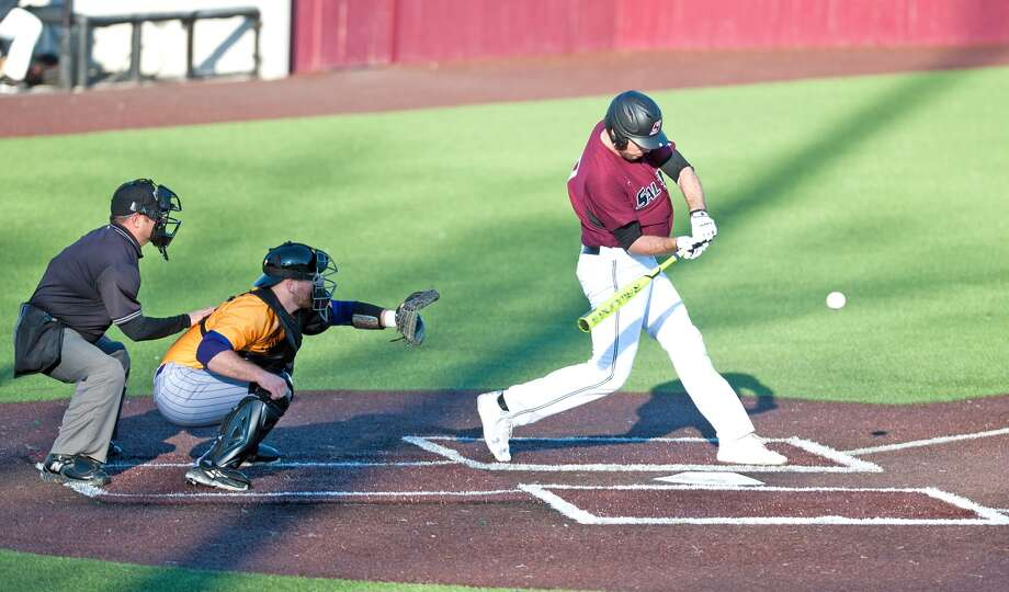 Drew Curtis of Southern Illinois University Carbondale, right, swings at a pitch during a game this spring. Curtis is a 2013 Edwardsville High School graduate.