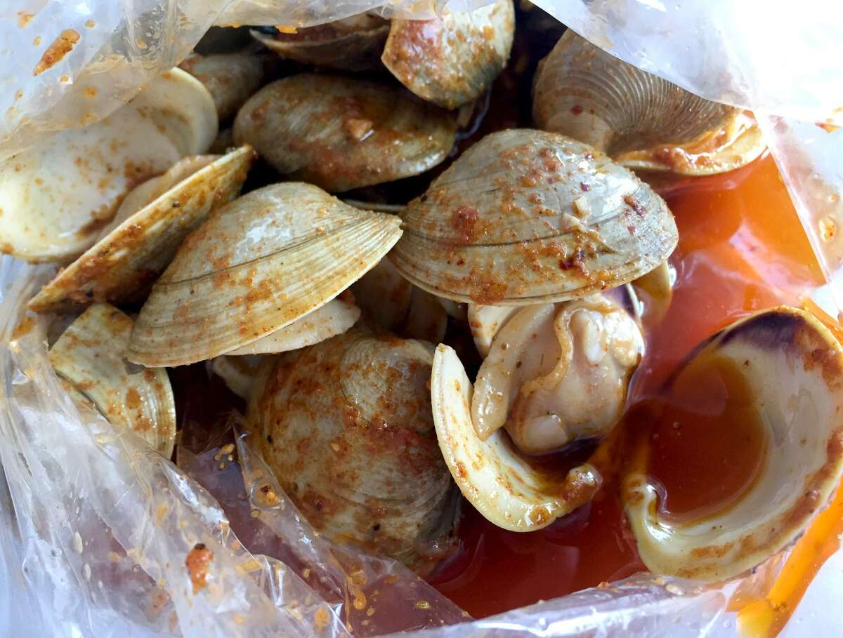 Clams served in a spicy sauce at Smashin Crab.