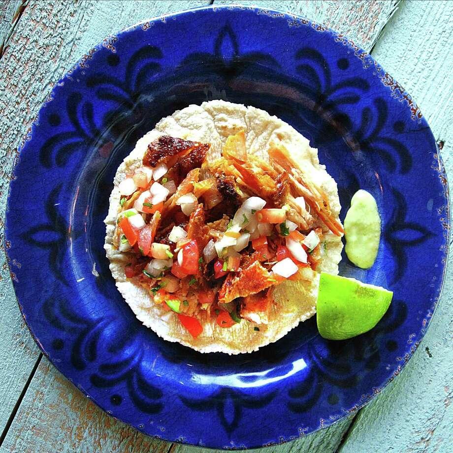 Soft pork-belly taco on a handmade corn tortilla from Sal-o-Mon Family Restaurant. Photo: Mike Sutter /San Antonio Express-News
