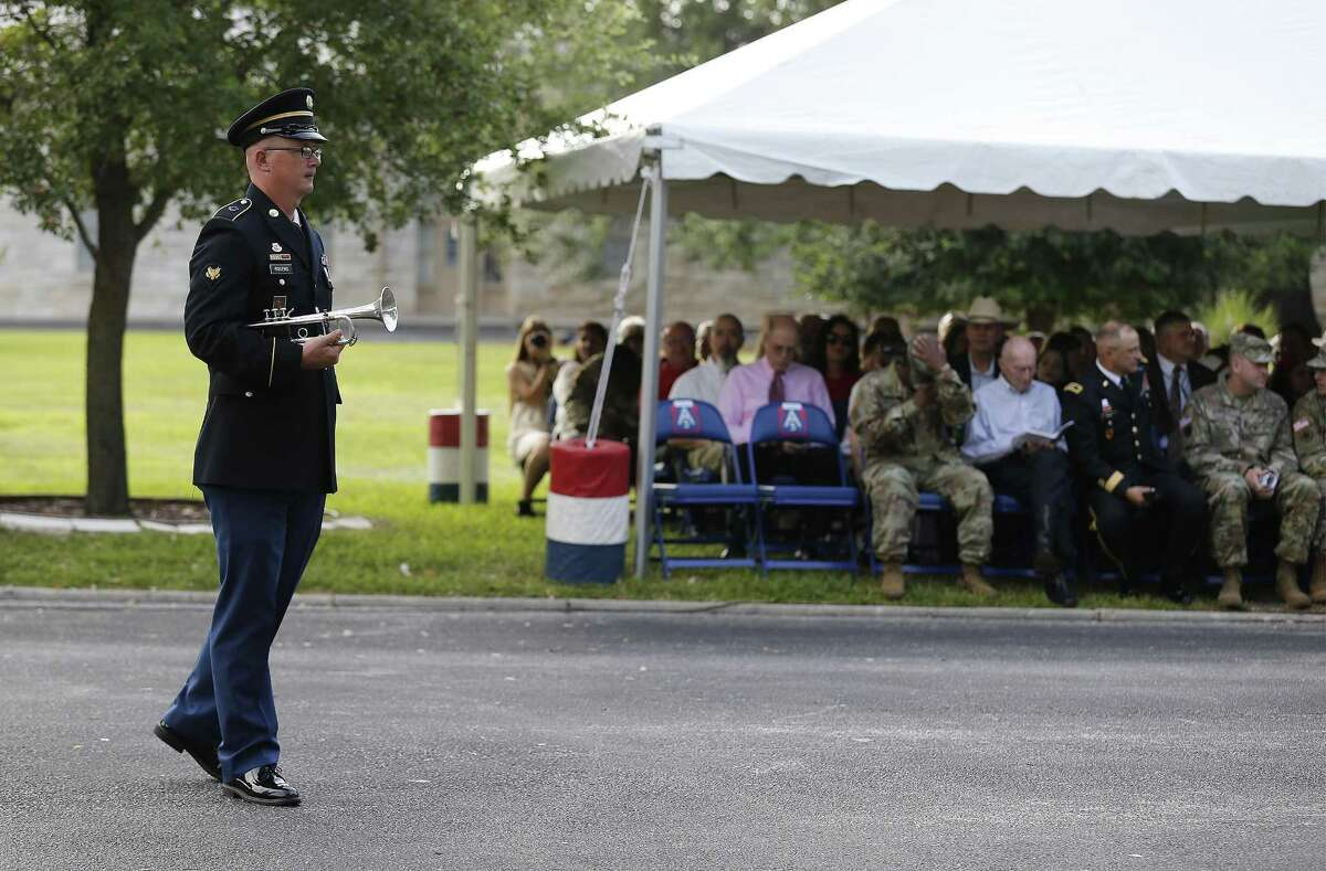 Spc. Timothy Rogers prepares to play his trumpet to commence a retirement ceremony at Fort Sam Houston on Thursday, June 29, 2017. In San Antonio, a U.S. Army town going back to statehood, one of its grand traditions for more than a century has been singing patriotic songs at various events to the strains of a band from Fort Sam Houston. That era is coming to an end. The Army is breaking up the 323rd Army Band, called Fort Sams Own, ending a run that has seen musicians from the post serenading everything from command change ceremonies and funerals for heroic soldiers to downtown parades.(Kin Man Hui/San Antonio Express-News)