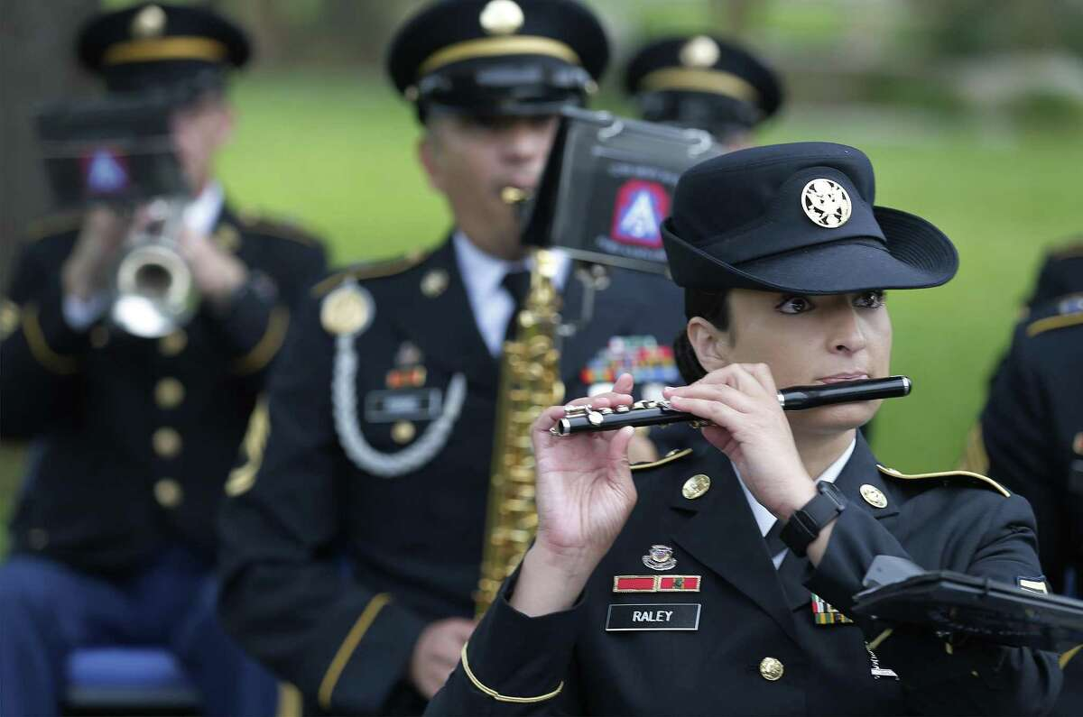 Sgt. Leanne Raley performs with the 323rd Army Band during a retirement ceremony at Fort Sam Houston on Thursday, June 29, 2017. In San Antonio, a U.S. Army town going back to statehood, one of its grand traditions for more than a century has been singing patriotic songs at various events to the strains of a band from Fort Sam Houston. That era is coming to an end. The Army is breaking up the 323rd Army Band, called Fort Sams Own, ending a run that has seen musicians from the post serenading everything from command change ceremonies and funerals for heroic soldiers to downtown parades.(Kin Man Hui/San Antonio Express-News)