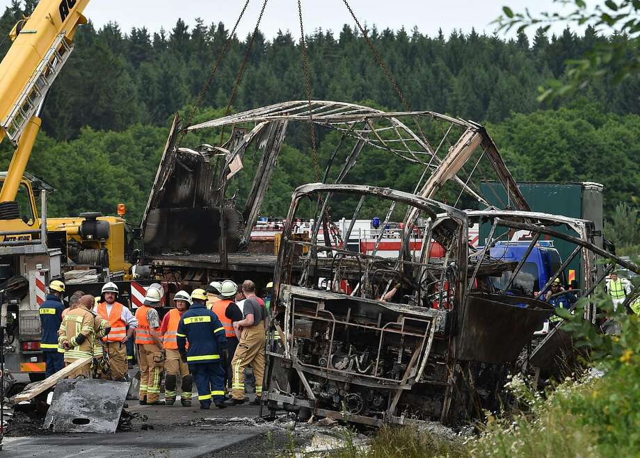 Emergency teams examine debris after a tour bus collided with a truck near Muenchberg, Germany. Photo: CHRISTOF STACHE, AFP/Getty Images