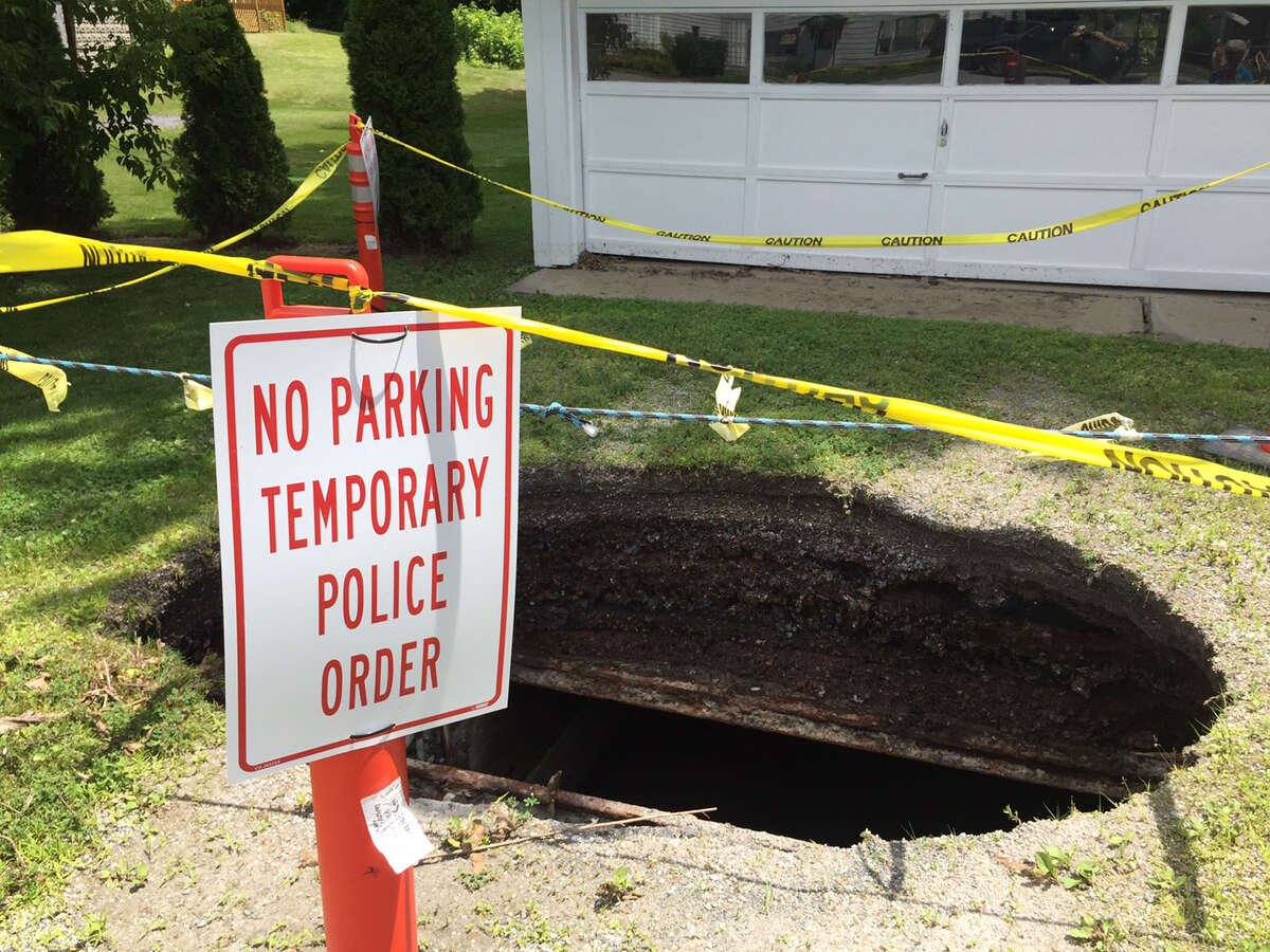 Flooding:Sinkhole in driveway of home on Monday, July 3, 2017, Hoosick Falls, N.Y. (Rob Gavin/Times Union)