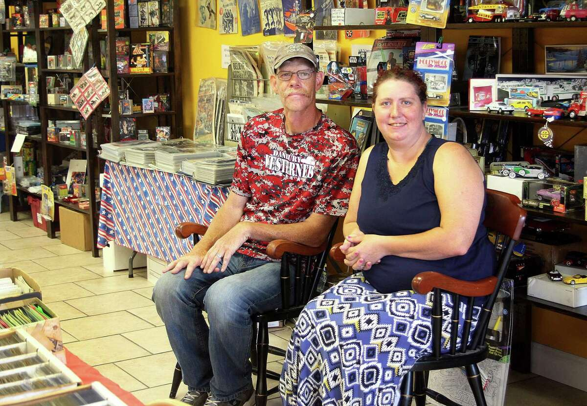 Bob Brought and Jolene Fako-Bought, owners of JMCollectibles, sit in their new store at 180-8 Old Hawleyville Road off Stony Hill Road in Bethel, Conn., on Saturday, July 1, 2017.