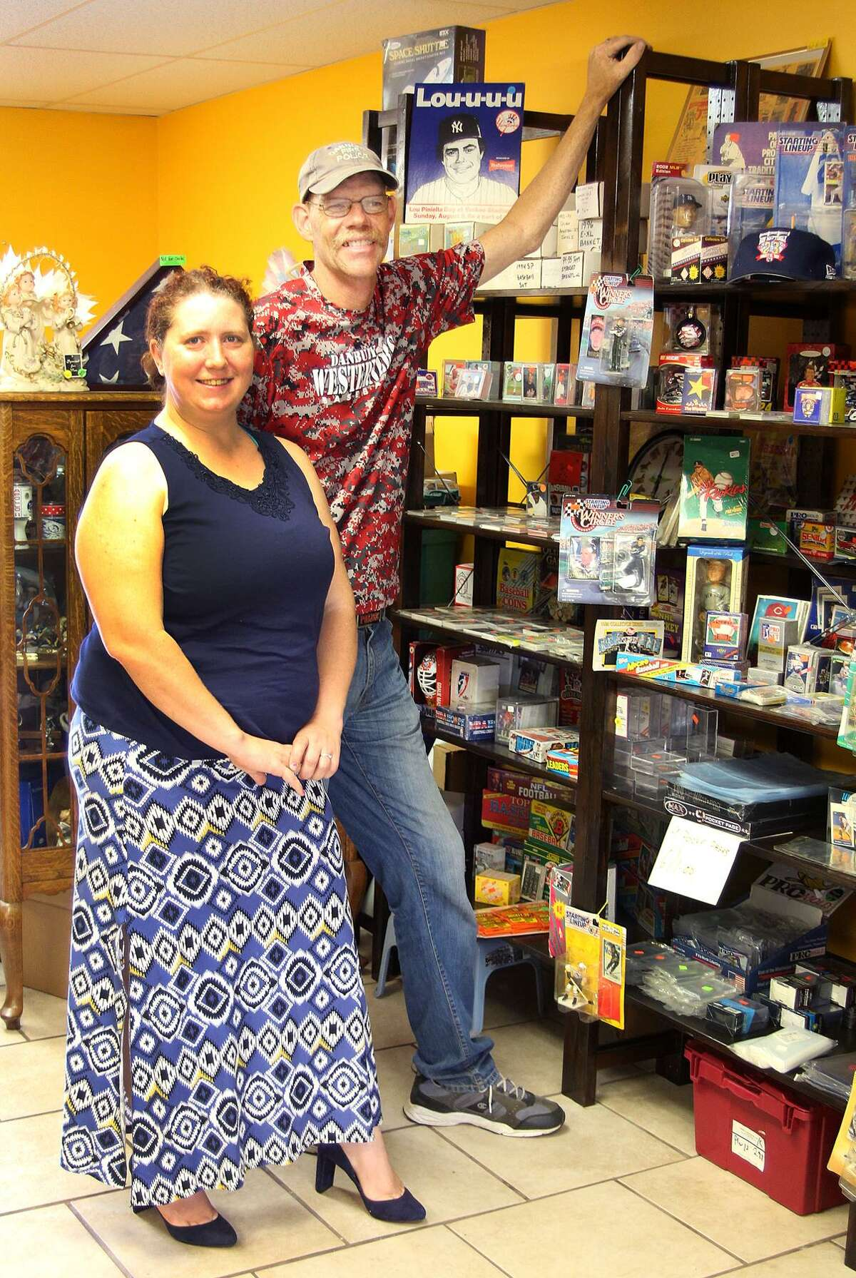 Bob Brought and Jolene Fako-Bought, owners of JMCollectibles, stand in their new store at 180-8 Old Hawleyville Road off Stony Hill Road in Bethel, Conn., on Saturday, July 1, 2017.