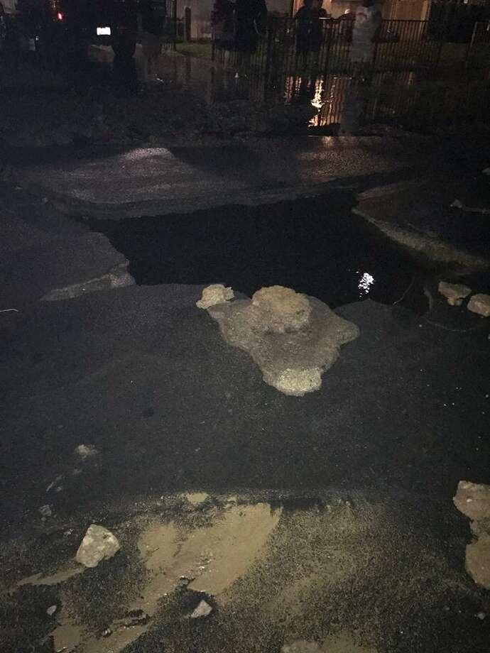 A large hole opened on Laurel Street in Napa Sunday night, officials said. Photo: Napa Police Department