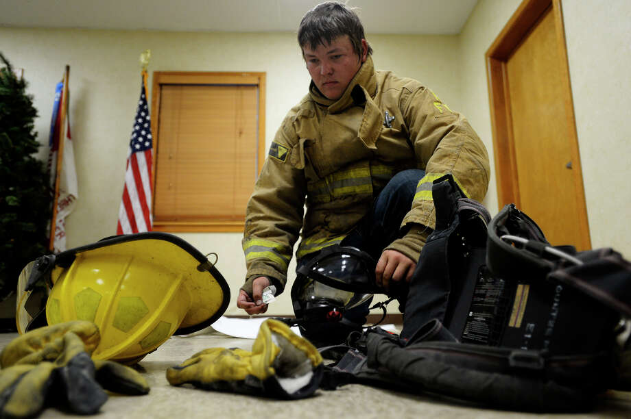 Justin Sticker, 18, practices putting on his fire gear at the Kountze Volunteer Fire Department on Monday evening. Sticker joined the department after firefighters helped him following a Nov. 12, 2014 car wreck that left him severely injured.  Photo taken Monday 6/26/17 Ryan Pelham/The Enterprise Photo: Ryan Pelham / ©2017 The Beaumont Enterprise/Ryan Pelham