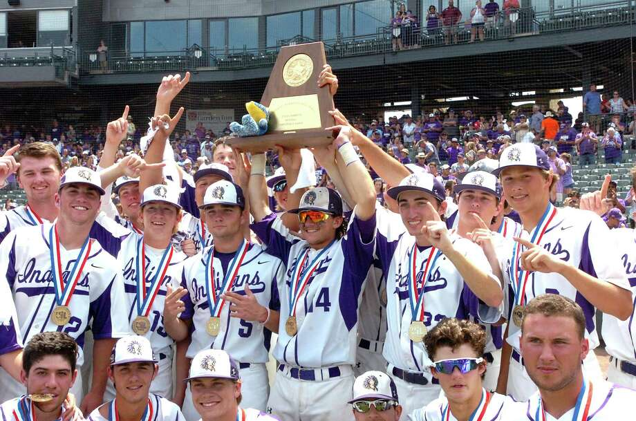 The Port Neches-Groves baseball team celebrates with the Class 5A state baseball championship trophy after the Indians defeated Grapevine, 4-2, on Saturday, June 10, at Dell Diamond in Round Rock. (Mike Tobias/The Enterprise) Photo: Mike Tobias/The Enterprise)