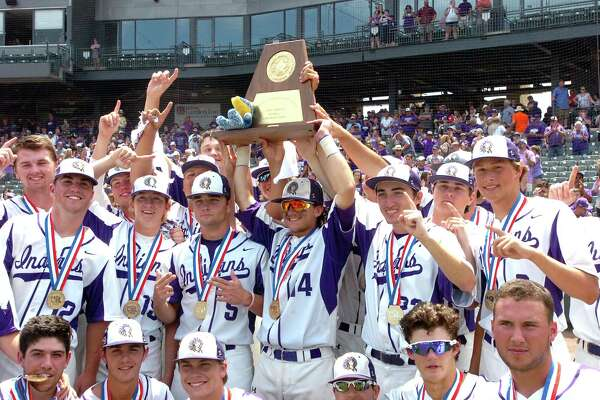 The Port Neches-Groves baseball team celebrates with the Class 5A state baseball championship trophy after the Indians defeated Grapevine, 4-2, on Saturday, June 10, at Dell Diamond in Round Rock. (Mike Tobias/The Enterprise)