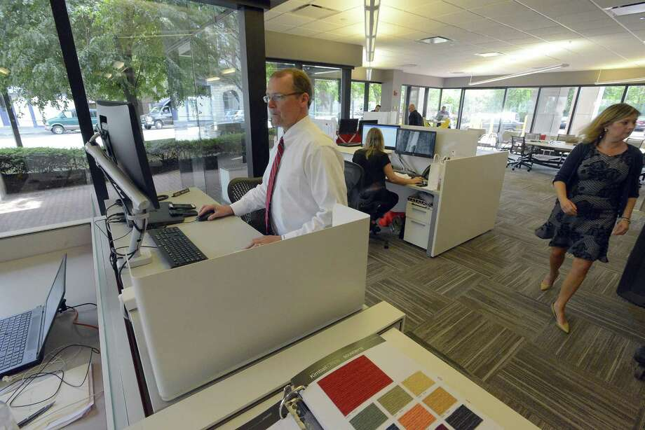 OFI Employees Work At Their Desks In The Office Furniture Firmu0027s New  Offices At 1010