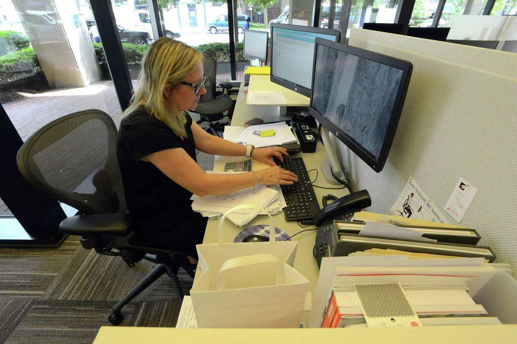 OFI Sales Associate Lone Albertsen Works At Her Desk In OFIs New Offices 1010 Washington