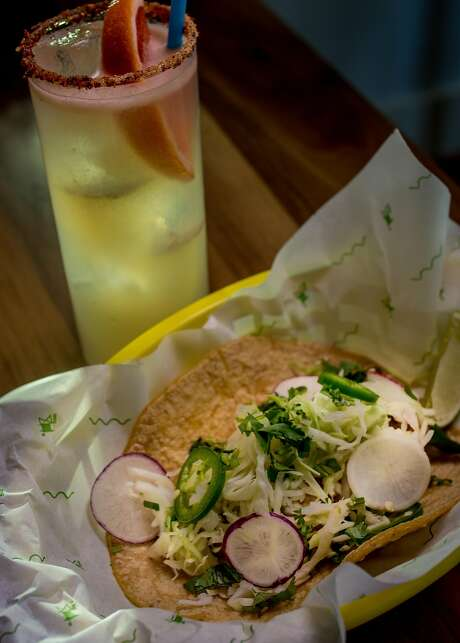 "The Pescado Taco with the ""Paloma"" cocktail. Photo: John Storey, Special To The Chronicle"