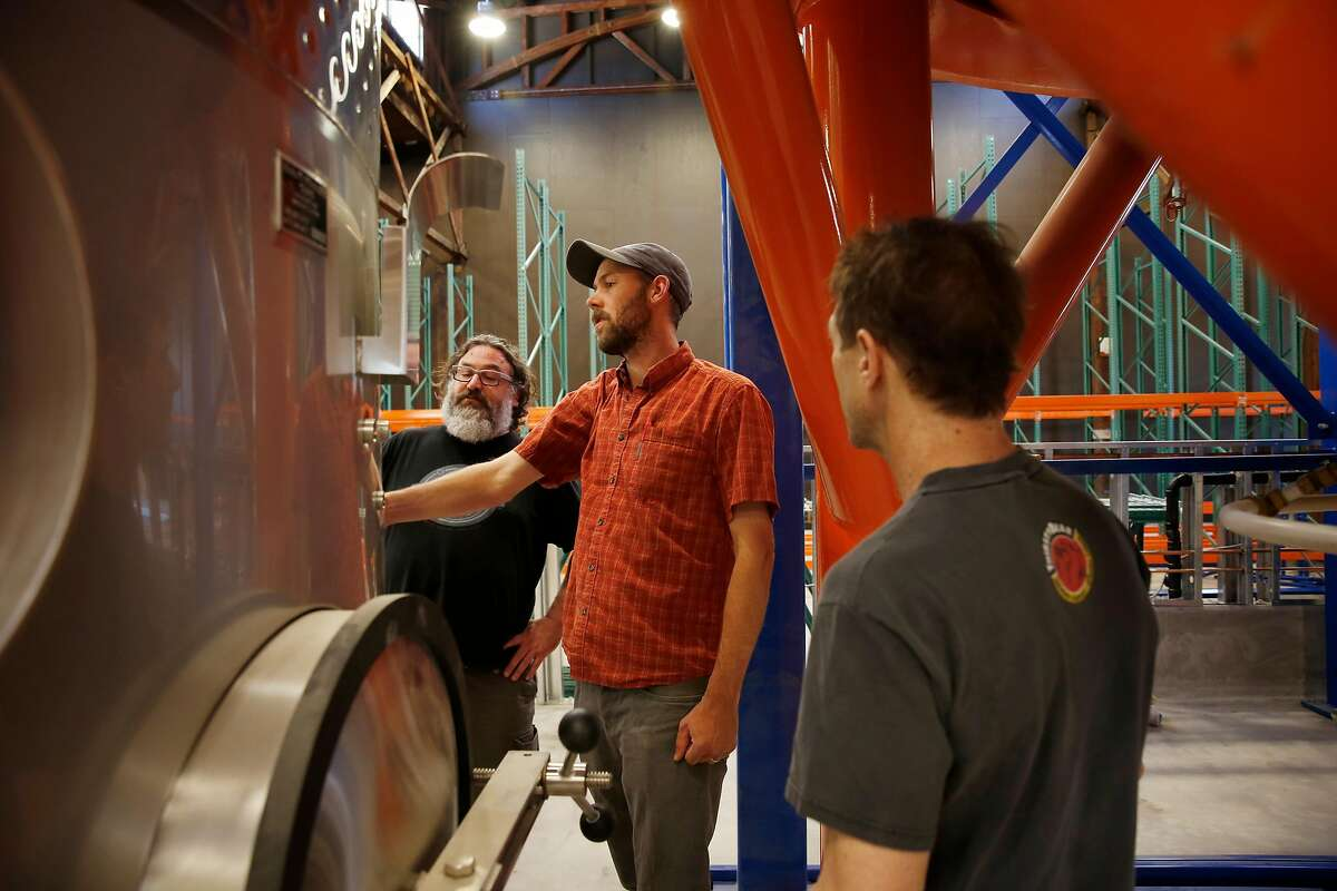 Admiral Maltings co-founders Dave McLean (l to r), Curtis Davenport and Ron Silberstein talk while looking over equipment at Admiral Maltings on Monday, June 26, 2017 in Alameda, Calif.