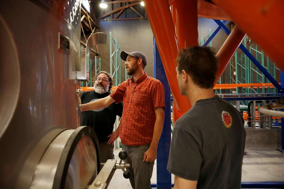 Admiral Maltings co-founders Dave McLean (l to r), Curtis Davenport and Ron Silberstein talk while looking over equipment at Admiral Maltings on Monday, June 26, 2017 in Alameda, Calif. Photo: Lea Suzuki / The Chronicle